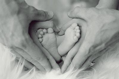 baby feet in hands