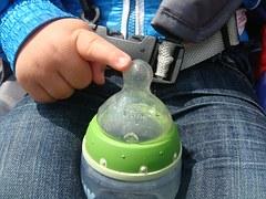 baby bottle in hands